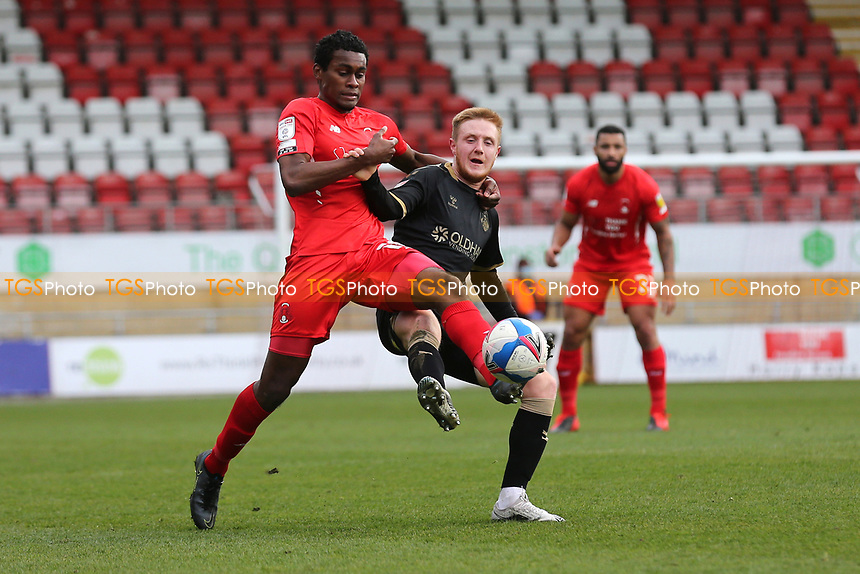 Tunji Akinola of Leyton Orient and Davis Keillor-Dunn of Oldham Athletic during Leyton Orient vs Oldham Athletic, Sky Bet EFL League 2 Football at The Breyer Group Stadium on 27th March 2021