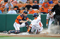 Virginia Cavaliers catcher Nate Irving #18 tags out a hard sliding Steven Duggar #9 during a game against the Clemson Tigers at Doug Kingsmore Stadium on March 15, 2013 in Clemson, South Carolina. The Cavaliers won 6-5.(Tony Farlow/Four Seam Images).