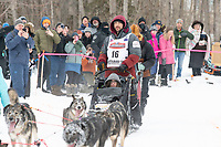 Richie Diehl and team run past spectators on the bike/ski trail near University Lake with an Iditarider in the basket and a handler during the Anchorage, Alaska ceremonial start on Saturday, March 7 during the 2020 Iditarod race. Photo © 2020 by Ed Bennett/Bennett Images LLC