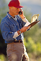 Farmer on mobile phone.