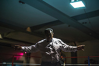A referee adjudicates at a white collar boxing event at the London Irish Centre where the 'Carpe Diem' boxing event is taking place. <br /> <br /> 'White-collar boxing' is a growing phenomenon amongst well paid office workers and professionals and has seen particular growth in financial centres like London, Hong Kong and Shanghai. It started at a blue-collar gym in Brooklyn in 1988 with a bout between an attorney and an academic and has since spread all over the world. The sport is not regulated by any professional body in the United Kingdom and is therefore potentially dangerous, as was proven by the death of a 32-year-old white-collar boxer at an event in Nottingham in June 2014. The London Irish Centre, amongst other venues, hosts a regular bout called 'Carpe Diem'. At most bouts participants fight to win. Once boxers have completed a few bouts they can participate in 'title fights' where they compete for a replica 'belt'.
