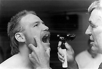Wendel Clark was among the Leaf faithful who turned up for yesterday's medical checkup at Maple Leaf Gardens. Here, Dr. Simon McGrail tells Clark, who has been battling back problems, to open wide.<br /> <br /> Photo : Boris Spremo - Toronto Star archives - AQP