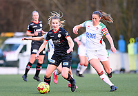 Laura Vervacke (20) of Zulte-Waregem pictured in a duel with Lenie Onzia (8) of OHL during a female soccer game between Oud Heverlee Leuven and SV Zulte-Waregem on the 16 th matchday of the 2020 - 2021 season of Belgian Womens Super League , sunday 14 th of March 2021  in Heverlee , Belgium . PHOTO SPORTPIX.BE | SPP | DAVID CATRY