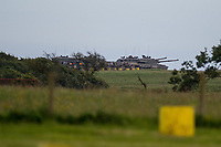 """Wednesday 14 June 2017<br /> Pictured: Tanks on the Castlemartin Range  <br /> Re: Paramedics and a fire crews are in attendance at what has been describes as an """"ongoing incident"""" at a military training base in Pembrokeshire.<br /> The Welsh Ambulance Service said it was alerted to an incident at the Castlemartin firing range just before 15:30 BST on Wednesday.<br /> The range is owned by the Ministry of Defence (MOD) Live firing was due to take place at the range from Monday to Friday.<br /> Mid and West Wales Fire and Rescue Service is also in attendance.<br /> Castlemartin is the only UK Army range normally available for direct-fire live gunnery exercises and is used by Army, Army reserves and cadets.<br /> It is also used by civilian organisations and research establishments."""