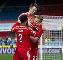 Aberdeen's Adam Rooney (9) is congratulated after he scores their first goal.