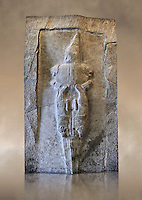 The sword of God from the Sancutary of Yazilikaza, Hattusha, Turkey. Probably the weirdest representation of the rock sanctuary Yazilikaza, shows a sword God. He is waering a high pointed cap, whose ornamented with horns showing he is a divine character. The lower part of his body is formed of two hanging lions that merge into a sword blade . The body of God seems to form the sword handle and the sword being stuck into the ground could indicate that there is a god of the underworld. Cast from the original. Vorderasiatisches Museum, Pergamon Museum, Berlin