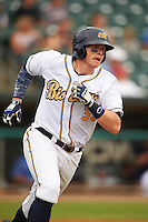 Montgomery Biscuits first baseman Cameron Seitzer (33) runs to first after hitting a home run during a game against the Tennessee Smokies on May 25, 2015 at Riverwalk Stadium in Montgomery, Alabama.  Tennessee defeated Montgomery 6-3 as the game was called after eight innings due to rain.  (Mike Janes/Four Seam Images)