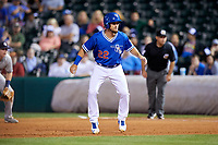Oklahoma City Dodgers pinch runner Drew Maggi (22) leads off first base during a game against the Colorado Springs Sky Sox on June 2, 2017 at Chickasaw Bricktown Ballpark in Oklahoma City, Oklahoma.  Colorado Springs defeated Oklahoma City 1-0 in ten innings.  (Mike Janes/Four Seam Images)