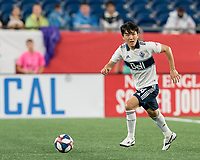 FOXBOROUGH, MA - JULY 18: Hwang In-Beom #4 brings the ball forward during a game between Vancouver Whitecaps and New England Revolution at Gillette Stadium on July 18, 2019 in Foxborough, Massachusetts.