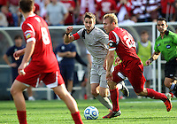 HOOVER, AL - DECEMBER 09, 2012: Caleb Konstanski (22) of Indiana University pushes past Steve Neumann (18) of Georgetown University during the NCAA 2012 Men's College Cup championship, at Regions Park, in Hoover , AL, on Sunday, December 09, 2012.