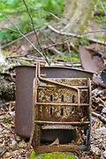 Artifact (mop bucket & wringer) at Camp 24 of the East Branch & Lincoln Railroad (1893-1948) in the Pemigewasset Wilderness of Lincoln, New Hampshire USA. This was a logging camp located along the Cedar Brook Branch of the EB&L Railroad.
