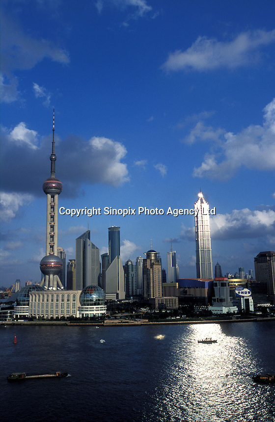 A view of Pud ong from the opposite bank pf the Huangpu river, with the Jin Mao Tower (Grand Hyatt hotel) reflecting the afternoon sun.