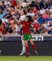 HOUSTON, TX - JUNE 10: Samantha Mewis #3 of the USWNT goes up for the ball with Dolores Silva #14 of Portugal during a game between Portugal and USWNT at BBVA Stadium on June 10, 2021 in Houston, Texas.