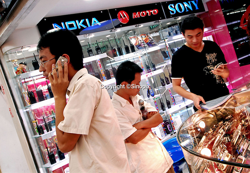 A customer look at mobile phones for sale at a shop selling Sony and Nokia products in Guangzhou, China. .