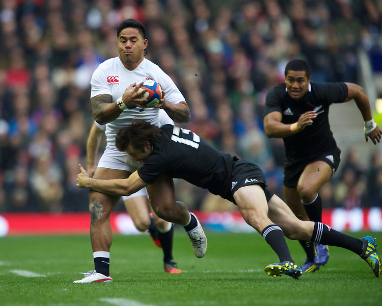 Manu Tuilagi of England is tackled by Conrad Smith of New Zealand during the QBE Autumn International match between England and New Zealand at Twickenham on Saturday 01 December 2012 (Photo by Rob Munro)