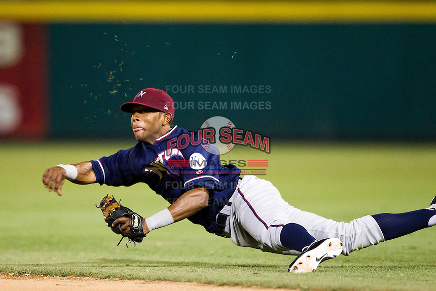 Rey Navarro (8) of the Northwest Arkansas Naturals throws to first while diving during a game against the Springfield Cardinals at Hammons Field on August 1, 2011 in Springfield, Missouri. Springfield defeated Northwest Arkansas 7-1. (David Welker / Four Seam Images).