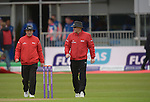 Umpires Mark Hawthorne and Ian Ramage walk to the wicket at the Ireland v England One Day Cricket International held at Malahide Cricket Club, Dublin, Ireland. 8th May 2015.<br /> Photo: Joe Curtis/www.newsfile.ie