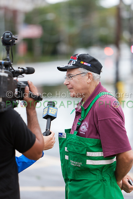 MAMARONECK, NY - AUGUST 28: Mayor Norman Rosenblum of the Village of Mamaroneck, New York is interviewed by a local news crew on Sunday August 28, 2011 in the aftermath of Hurricane Irene.