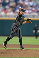 Vanderbilt Commodores pitcher Carson Fulmer (15) makes a pickoff throw to first base during the NCAA College baseball World Series against the Cal State Fullerton Titans on June 14, 2015 at TD Ameritrade Park in Omaha, Nebraska. The Titans were leading 3-0 in the bottom of the sixth inning when the game was suspended by rain. (Andrew Woolley/Four Seam Images)