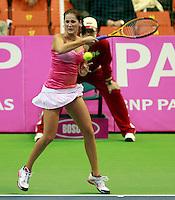 Serbian Fed Cup tennis player Bojana Jovanovski returns the ball during match against Aleksandra Wozniak from Canada in Fed Cup match Serbia vs Canada, Novi Sad, Serbia, SPENS Sports Center, Saturday, February 05, 2011. (credit & photo: Pedja Milosavljevic / +381641260959 / thepedja@gmail.com / STARSPORT)