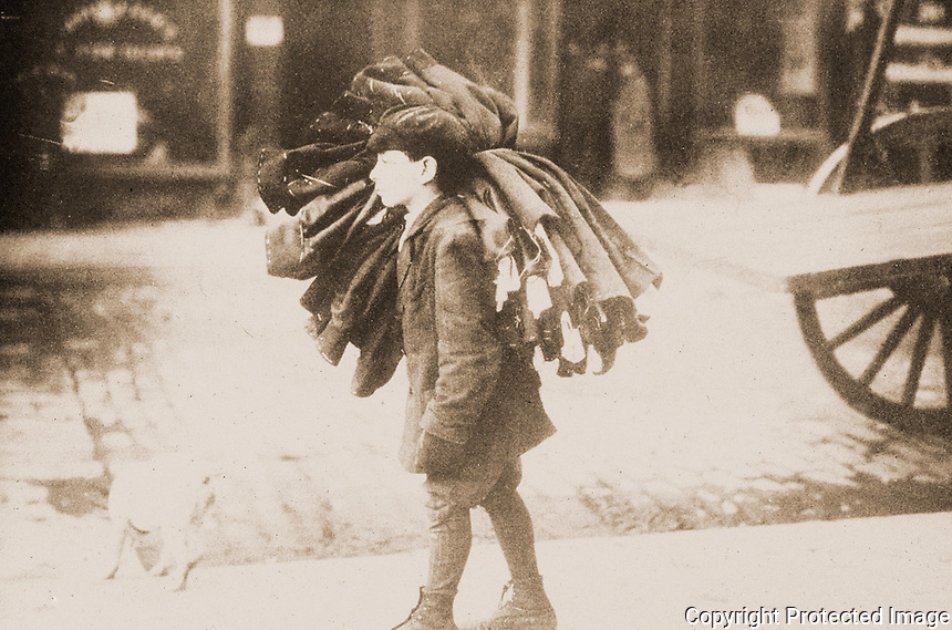 """Historical Photo:  """"Carrying Work Home, c. 1910"""" .   Unknown photographer. Schoener, p. 175.  Photo '78."""