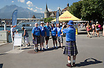 FC Luzern v St Johnstone...16.07.14  Europa League 2nd Round Qualifier<br /> Fans arrive in Lucerne...Saints fan Lummy takes a photo of his pals with manager Tommy Wright on the Schweizerhofquai overlooking the Vierwaldstattersee they are from left, Fergie, Dakes, Suz and Mik<br /> Picture by Graeme Hart.<br /> Copyright Perthshire Picture Agency<br /> Tel: 01738 623350  Mobile: 07990 594431