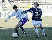 SWI Harelbeke - BS Poperinge ..Tim Pylyser (rechts) trekt aan de trui van Vladan Devic (links)..foto VDB / BART VANDENBROUCKE