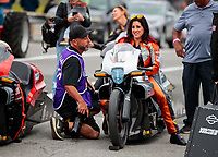 Sep 13, 2019; Mohnton, PA, USA; NHRA pro stock motorcycle rider Angelle Sampey talks with photographer Gary Nastase during qualifying for the Keystone Nationals at Maple Grove Raceway. Mandatory Credit: Mark J. Rebilas-USA TODAY Sports