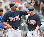 17 March 2009: Jeff Francoeur, left, of the Atlanta Braves congratulates Josh Anderson after Anderson's homer in a game against the New York Mets at the Braves' Spring Training camp at Disney's Wide World of Sports in Lake Buena Vista, Fla. Photo by: Tom Priddy/MiLB