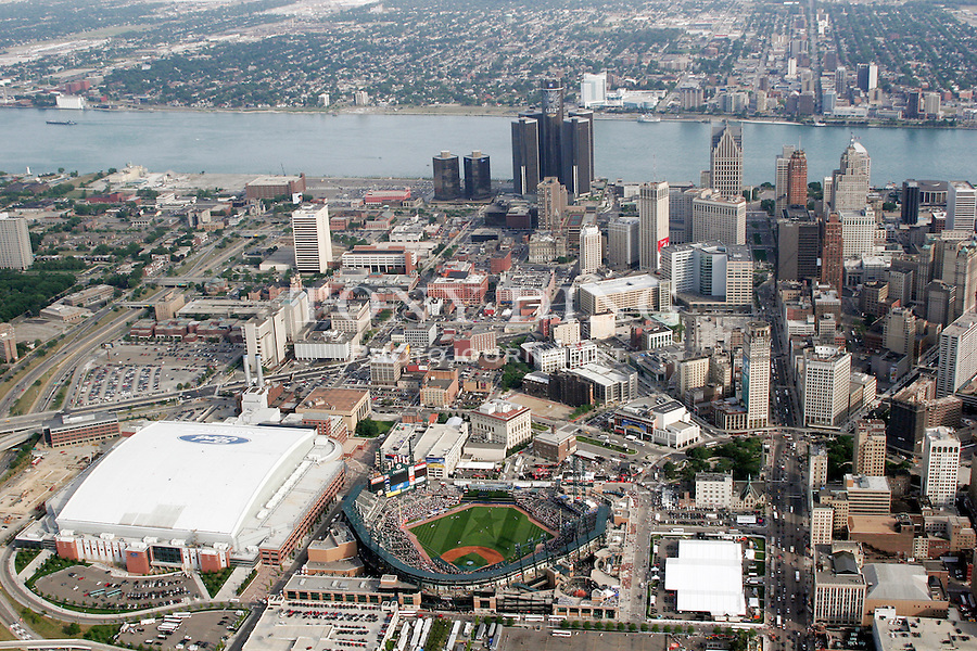 """Aerial view of downtown Detroit with Comerica Park at bottom center, Ford Field at bottom left, and the Renaissance Center at top, taken from on board the Akron, Ohio based """"Spirit of Goodyear"""" airship on Monday, July 11, 2005 before the start of the 2005 Major League Baseball All-Stars Home-run Derby. (AP Photo/Tony Ding)."""