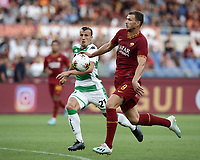 Football, Serie A: AS Roma - Sassuolo, Olympic stadium, Rome, September 15, 2019. <br /> Roma's Edin Dzeko (r) in action with Sassuolo's Vlad Chiriches (l) during the Italian Serie A football match between Roma and Sassuolo at Olympic stadium in Rome, on September 15, 2019.<br /> UPDATE IMAGES PRESS/Isabella Bonotto