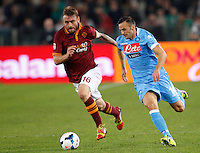 Calcio, Serie A: Roma vs Napoli. Roma, stadio Olimpico, 18 ottobre 2013.<br /> Napoli midfielder Giandomenico Mesto is chased by AS Roma midfielder Daniele De Rossi, left, during the Italian Serie A football match between AS Roma and Napoli at Rome's Olympic stadium, 18 October 2013.<br /> UPDATE IMAGES PRESS/Riccardo De Luca