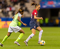 REIMS, FRANCE - JUNE 08: Ngozi Ebere #4 approaches Caroline Graham Hansen #10 during a game between Norway and Nigeria at Stade Auguste-Delaune on June 8, 2019 in Reims, France.