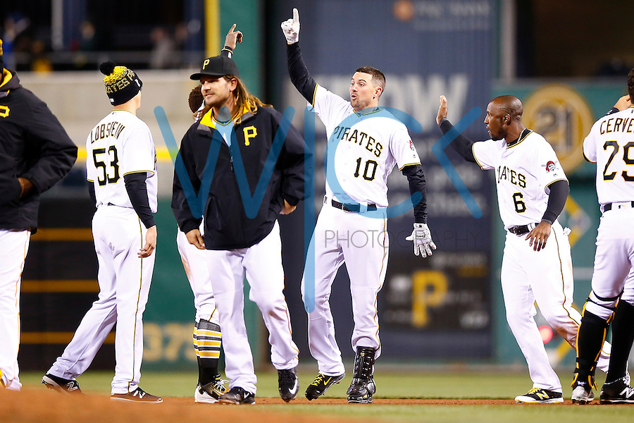 Jordy Mercer #10 of the Pittsburgh Pirates celebrates their walk-off win against the St. Louis Cardinals with teammates during the game at PNC Park in Pittsburgh, Pennsylvania on April 5, 2016. (Photo by Jared Wickerham / DKPS)