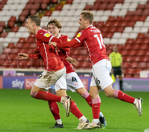 21st November 2020, Oakwell Stadium, Barnsley, Yorkshire, England; English Football League Championship Football, Barnsley FC versus Nottingham Forest; Cauley Woodrow of Barnsley celebrates 88 min goal with Callum Styles of Barnsley  and Mads Juel Andersen of Barnsley