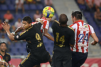BARRANQUIILLA -COLOMBIA-10-AGOSTO-2014. Jorge Ortega   (Der) y William Tesillo (3Der) del Atletico Junior  disputa el balon con Jorge Ramos (Izq) y Jair Palacios (2Der)  de Fortaleza FC , partido de la Liga  Postobon cuarta  fecha disputado en el estadio Metroplitano. / Jorge Ortega (R) and William Tesillo (3R) Atletico Junior fights for the ball with Jorge Ramos (L) and Jair Palacios (2R) of  Fortaleza FC, ??party Postobon League fourth round match at the Metropolitano stadium.. Photo: VizzorImage / Alfonso Cervantes / Stringer