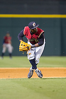 Scranton/Wilkes-Barre RailRiders third baseman Adonis Garcia (10) fields a ground ball against the Charlotte Knights at BB&T Ballpark on July 17, 2014 in Charlotte, North Carolina.  The Knights defeated the RailRiders 9-5.  (Brian Westerholt/Four Seam Images)