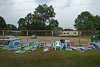 Pool chairs lined up along fence line