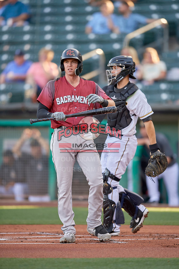 Zach Green (12) of the Sacramento River Cats looks for the sign against the Salt Lake Bees at Smith's Ballpark on July 18, 2019 in Salt Lake City, Utah. The Bees defeated the River Cats 9-6. (Stephen Smith/Four Seam Images)