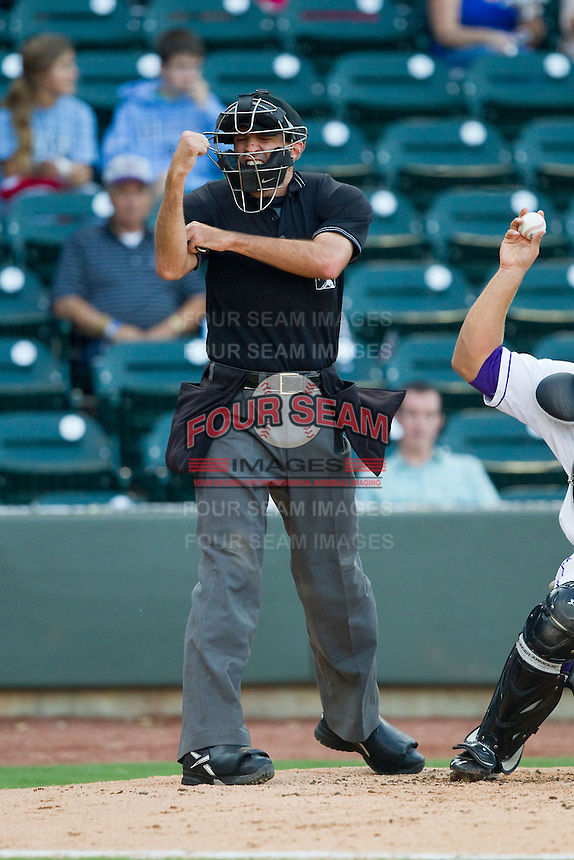 Home plate umpire Brian Miller makes a strike call during the Carolina League game between the Salem Red Sox and Winston-Salem Dash at BB&T Ballpark on August 15, 2013 in Winston-Salem, North Carolina.  The Red Sox defeated the Dash 2-1.  (Brian Westerholt/Four Seam Images)