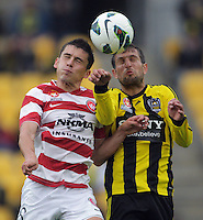 Mateo Poljak (left) and Vinnie Lia compete for a header during the A-League football round nine match between Wellington Phoenix and West Sydney Wanderers at Westpac Stadium, Wellington, New Zealand on Sunday, 2 December 2012. Photo: Dave Lintott / lintottphoto.co.nz