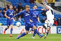 Ryan Tunnicliffe of Millwall is marked by Danny Ward of Cardiff City during the Sky Bet Championship match between Cardiff City and Millwall at The Cardiff City, Cardiff, Wales, UK. Saturday 28 October 2017