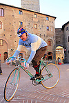 Old timer in traditional gear on vintage Bianchi before the start of the 2015 Strade Bianche Eroica Pro cycle race 200km over the white gravel roads from San Gimignano to Siena, Tuscany, Italy. 7th March 2015<br /> Photo: Eoin Clarke www.newsfile.ie
