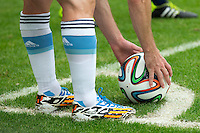 Lionel Messi of Argentina places the ball down for a corner