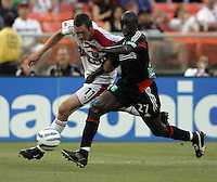 June 15, 2005; Washington, DC, USA; DC United's John Wilson (27) tries to keep the Chicago Fire's Nate Jaqua (11) away from the ball at RFK Stadium. DC United  won the game, 4-3.