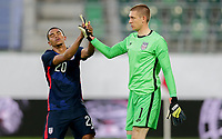 ST. GALLEN, SWITZERLAND - MAY 30: Reggie Cannon #20 and Ethan Horvath #1 of the United States high five each other during a game between Switzerland and USMNT at Kybunpark on May 30, 2021 in St. Gallen, Switzerland.