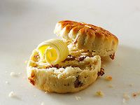 Traditional raison scone and butter food photos.