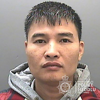 """Pictured: Bang Xuan Luong<br /> Re: The ringleaders of a Vietnamese crime gang have been jailed after police seized 2.5 tonnes of cannabis worth about £6m in raids across south Wales.<br /> A total of 21 people have been sentenced in a case going back to 2017 after dozens of cannabis factories were uncovered across the region and beyond.<br /> One of the defendants initially claimed to be 14 years old, but police proved he was actually aged 26.<br /> The gang leaders were sentenced at Merthyr Tydfil Crown Court on Friday.<br /> Bang Xuan Luong, 44, was sentenced to eight years in prison. His partner, 42-year-old Vu Thi Thu Thuy, was jailed for six years and Tuan Anh Pham, 20, who was described in court as the """"IT Man"""", received five years.<br /> An investigation into a cannabis factory in the Cynon Valley led officers from South Wales Police's Force Intelligence and Organised Crime Unit (FIOCU) to a string of others across south Wales, Gwent and Dyfed-Powys force areas."""