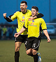 Stranraer's Andrew Stirling (11) celebrates with Steven Bell (14) after he scores their goal.