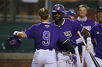 Daylan Nanny (9) of the Western Carolina Catamounts is greeted by teammate Immanuel Wilder (7) after hitting a home run during the game against the St. John's Red Storm at Childress Field on March 12, 2021 in Cullowhee, North Carolina. (Brian Westerholt/Four Seam Images)